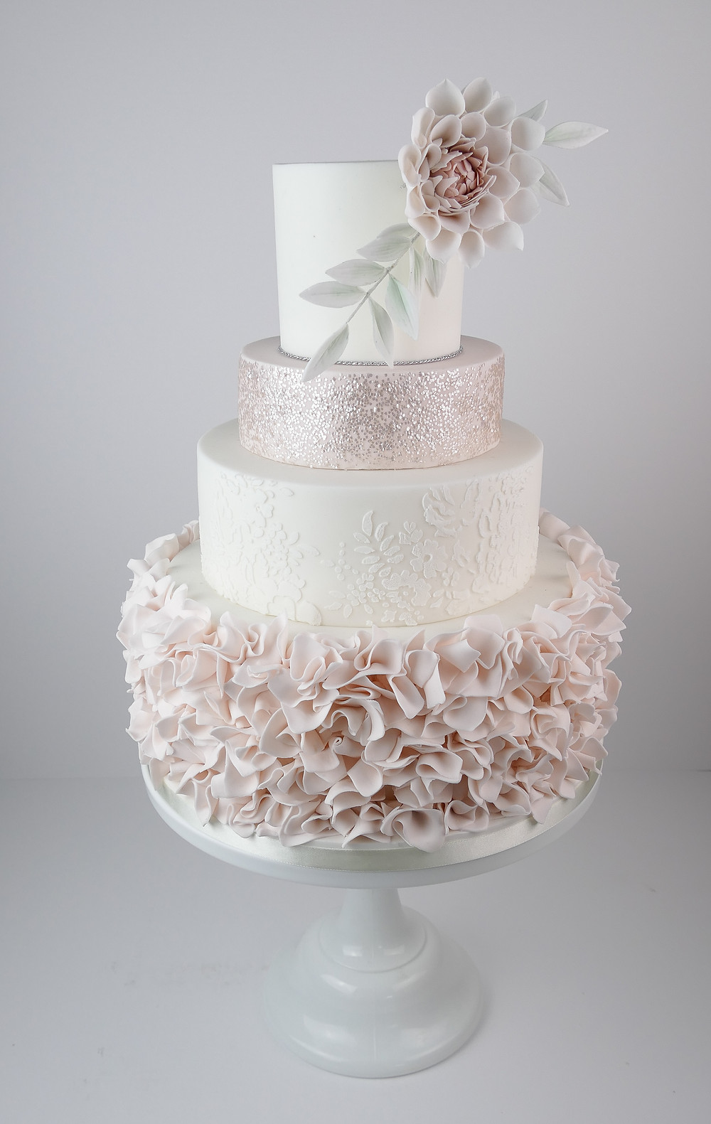 Pink ruffle and glitter wedding cake