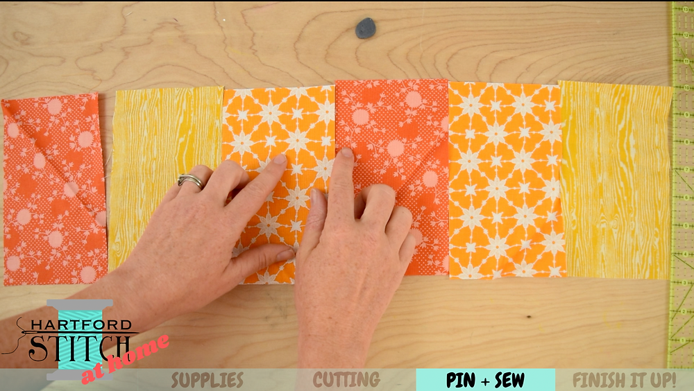 Fabric layout for handmade scrap fabric pumpkin sewing tutorial by Hartford Stitch.