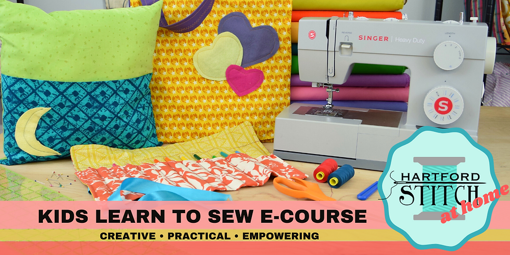 """Bright colorful projects including a green and blue pillow with a yellow crescent moon, a yellow messenger bag with multi colored hearts, a colored pencil roll up in red floral. Plus sewing machine, bolts of fabric and various sewuing tools. A banner at the bottom reads """"Kds Learn to Sew E-Course. Creative, practical, empowering. Also shown: a Hartford Stitch at Home logo"""