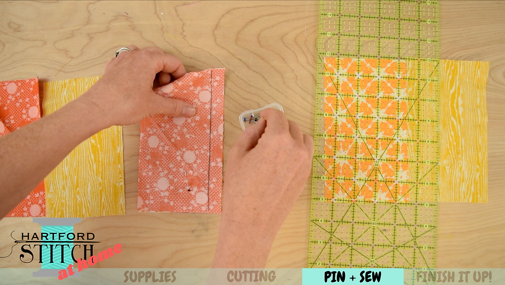 Pinning fabric for handmade scrap fabric pumpkin sewing tutorial by Hartford Stitch.