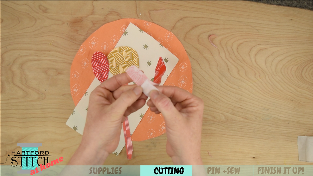 How to use double sided fusible webbing to make handmade applique place mat on Hartford Stitch at Home video.