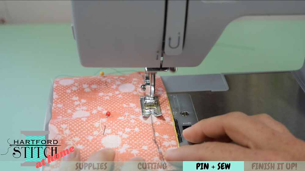 Sewing on a sewing machine for handmade scrap fabric pumpkin sewing tutorial by Hartford Stitch.
