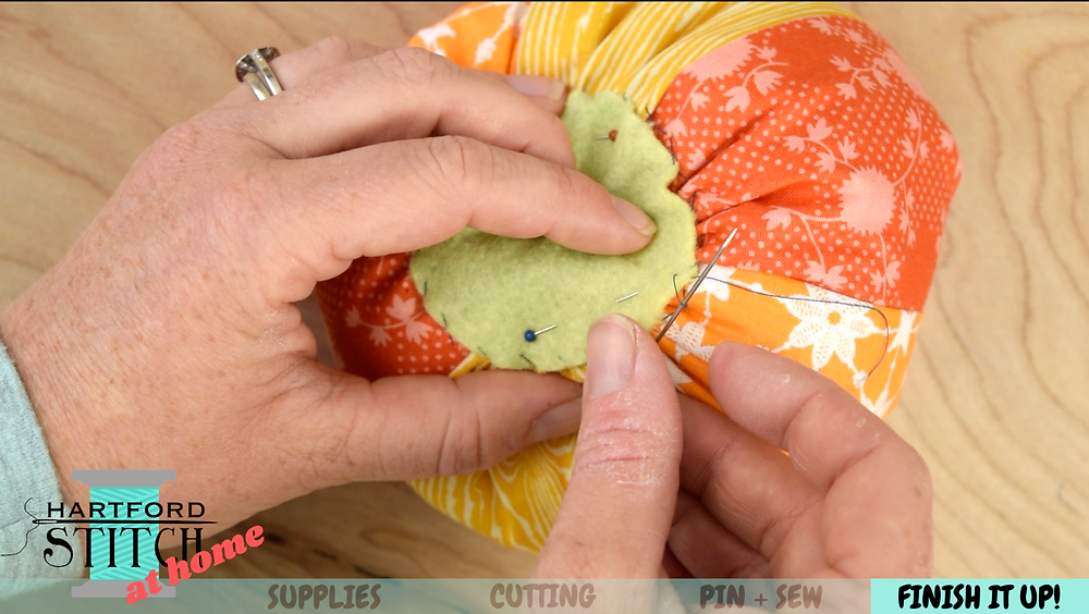 Handsewing using a whipstitch for handmade scrap fabric pumpkin sewing tutorial by Hartford Stitch.