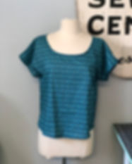 A dress form wearing a blue and green short sleeve shirt with a scoop neck made in the Garment 101 class at Hartford Stitch sewing school in West Hartford, CT