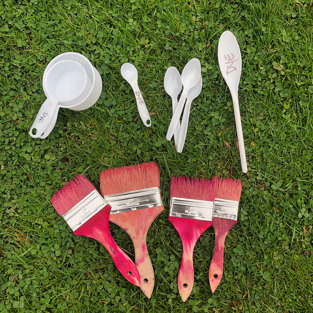 Measuring cups, spoons and paintbrushes for paint dyeing fabric with Procion dyes
