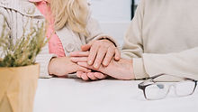 senior-couple-at-table-holding-hands.jpg
