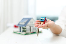 real-estate-agent-with-house-model-and-keys.jpg