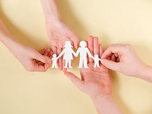 people-holding-together-in-hands-cute-paper-family.jpg