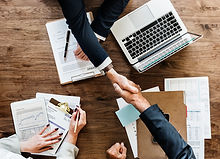 business-people-shaking-hands-together.jpg