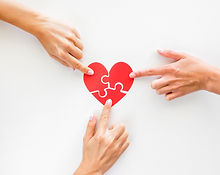 top-view-of-hands-touching-puzzle-heart-pieces.jpg
