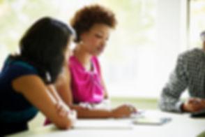Black-woman-in-a-meeting.jpg