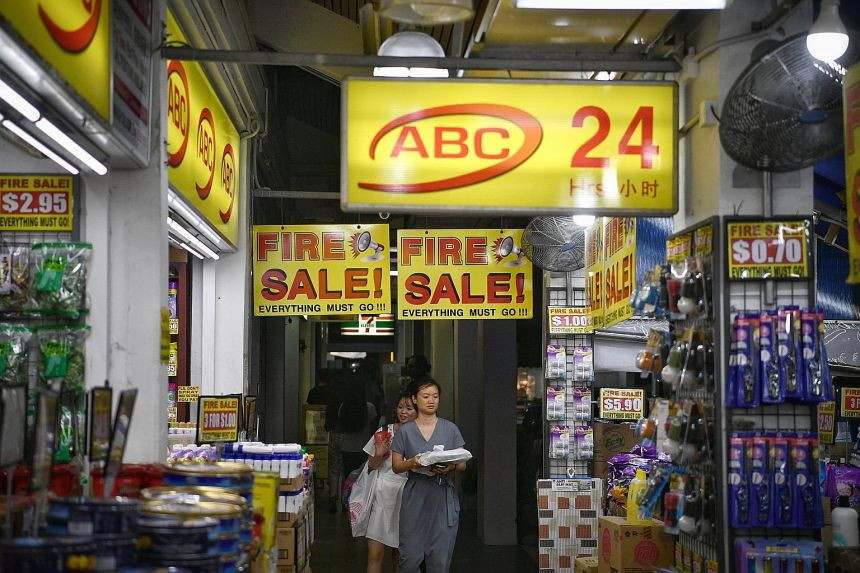 Multiple signboards promoting valuable deals, placed all over the shop