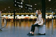 woman-sitting-on-luggage-3943882.jpg