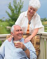 Seniors wearing pendants outside