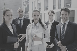 confident-businesspeople-standing-outside-office-building_edited.jpg