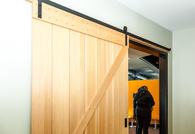02 lobby 1 barn door leading to restroom