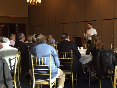 Sam discussing the Ukrainian refugee crisis with a synagogue group on Long Island.