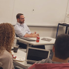 Sam giving a talk on journalism to students at Boston University.