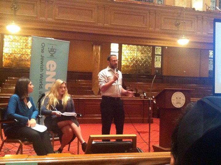 Sam speaking about refugees and antisemitism at an event sponsored by the JDC at Manhattan's Spanish and Portuguese Synagogue.