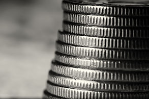 Stack of coins black and white macro.jpg