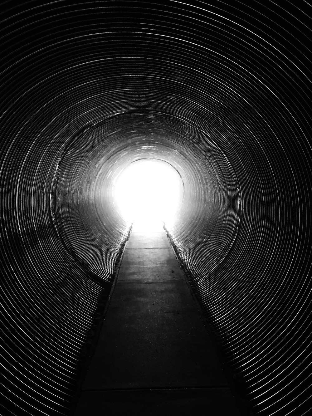 A dark tunnel with light at the end.