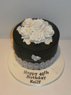 Black and white lace and rose cake