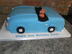 Teddy in a car cake