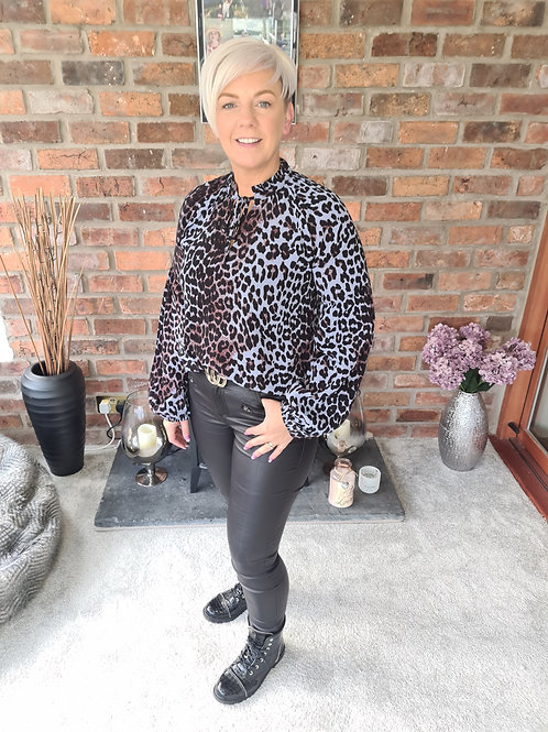 Blue animal print blouse by B Young