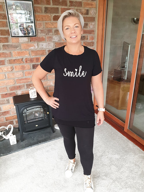 Black tee with smile logo by A Postcard from Brighton