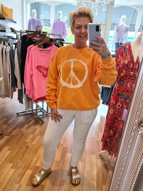 Orange peace logo sweater by Sundae Tee