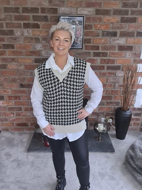 White shirt with black and white over top