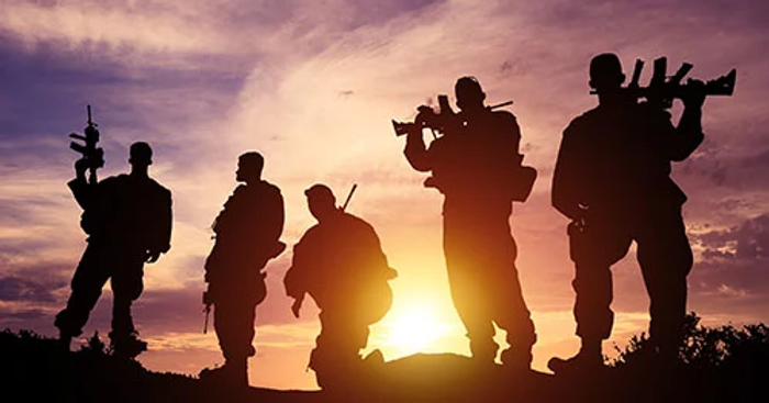 Military group backlit at sunset.png