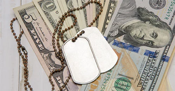 Dog tags sitting on US currency.png