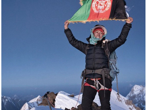 An Afghan woman, on top the (tallest) mountain