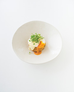 Fish cakes with eggs and hollandaise