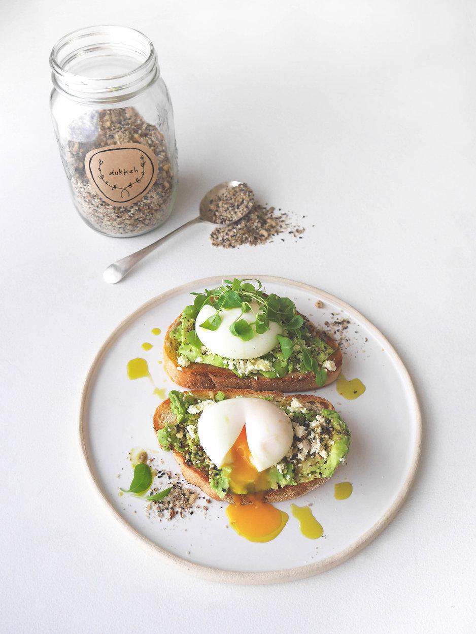 Avocado eggs with feta and dukkah