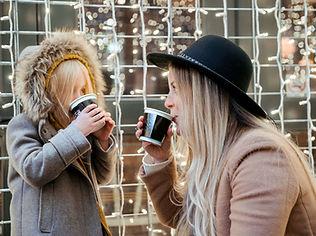 mother-daughter-sharing-hot-beverages_44