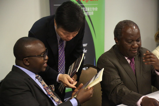 Dr. Niu Zhiqiang introducing the guideline for doing responsible business in East Africa to The Deputy Minister is called, Hon. Anthony Mavunde (MP), Deputy Minister of State in the Prime Minister's Office responsible for Policy, Parliamentary Affairs, Labour, Employment, Youth and Disabled. Dr. Aggrey K. Mlimuka, ED, ATE to the left.