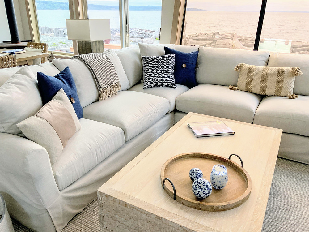 Beachy living room decorated with slipcovered sectional and throw pillows