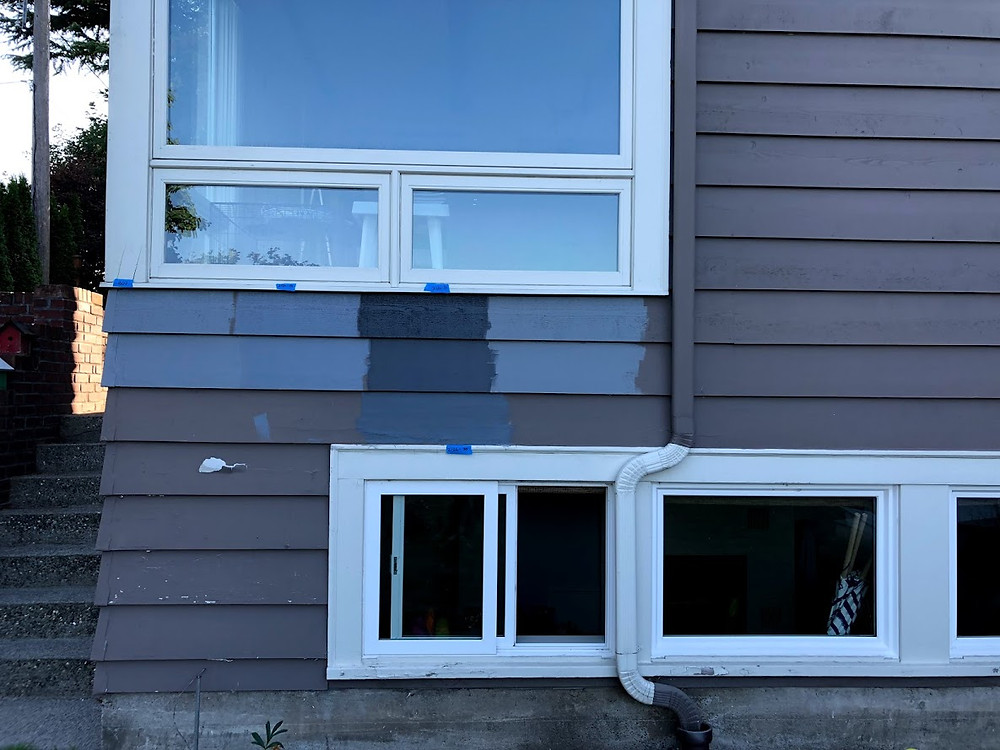 Paint samples on the side of a house
