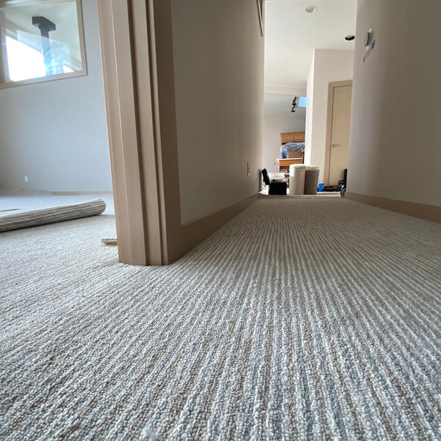 Striped carpet adds a relaxed vibe