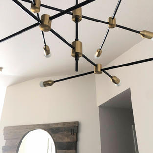 Entry chandelier and reclaimed wood mirror