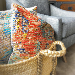 Basket of oversized pillows for movie nights and video games