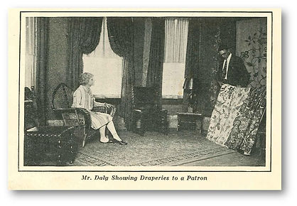 Robin Daly's grandfather, Walter J. Daly Sr. is helping a client choose a drapery fabric