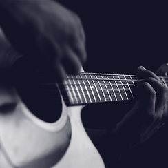 close up of person playing a guitar