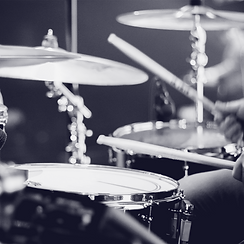 close up image of person playing the drums