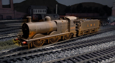 Weathered locomotive and Deeley Tender