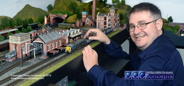Sales Manager Richard Brighton beside the Build a Model Railway at Studio Scotland