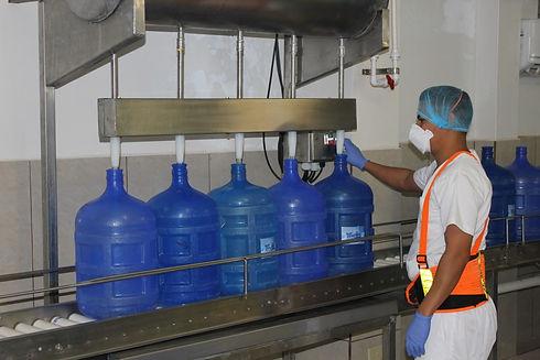 Jorge filling 5-20 Liter bottles at a ti