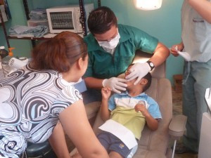 Dr. Alex explains her son's dental problem to Mom
